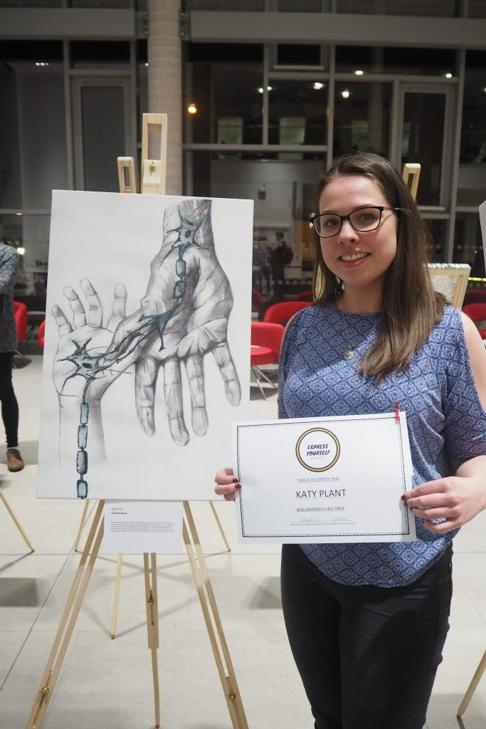 Katy Plant with her first prize winning artwork and certificate