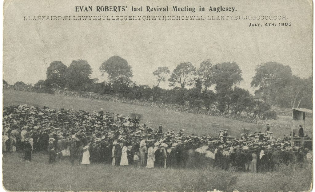 Archive image showing Welsh people gathered in a field