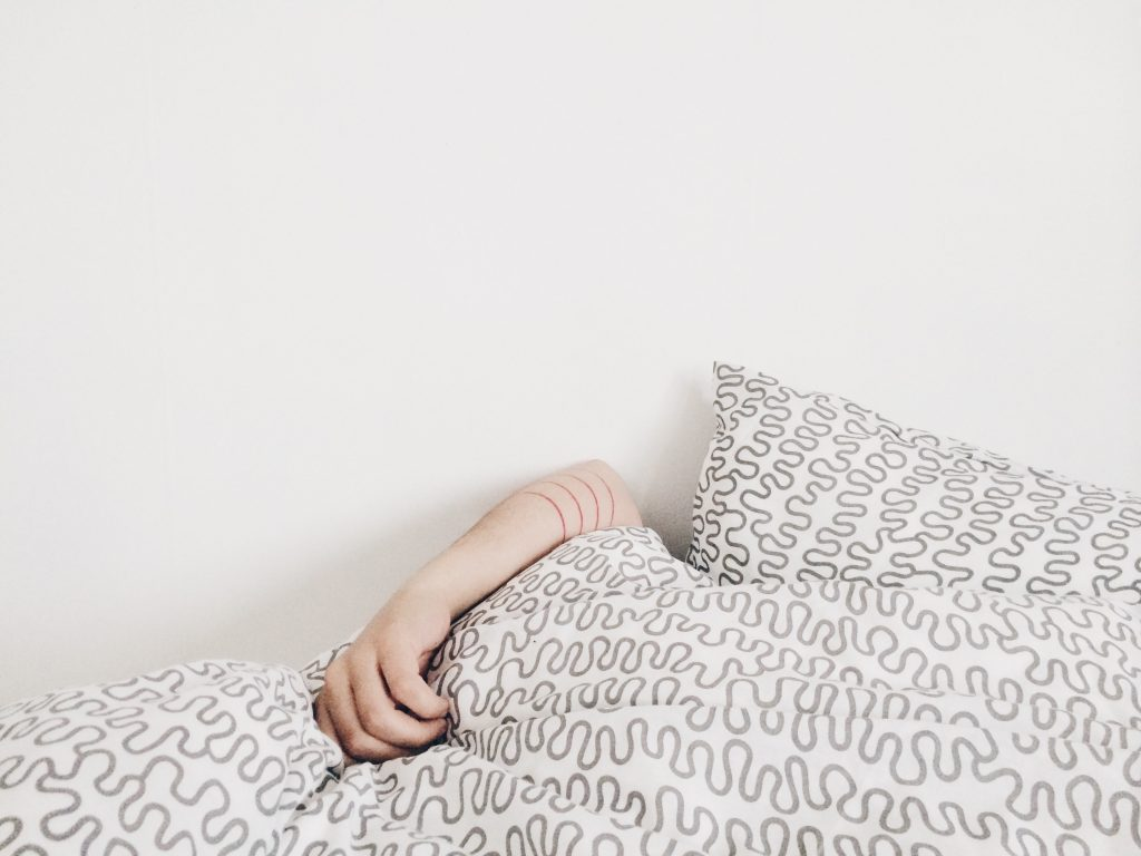 arm sticking out from under duvet