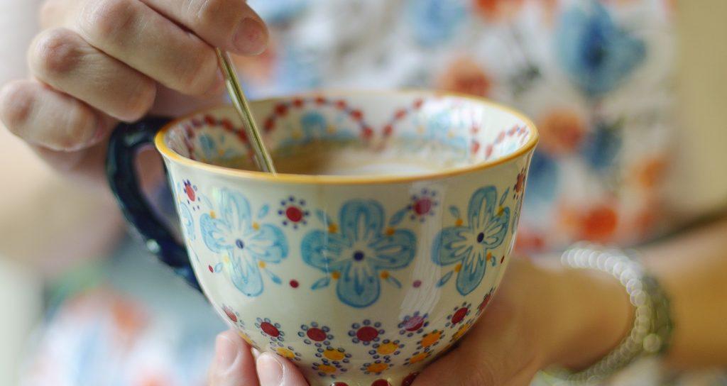 woman stirring cup of tea