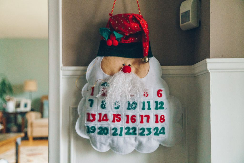 advent calendar in the shape of santa hanging on the wall