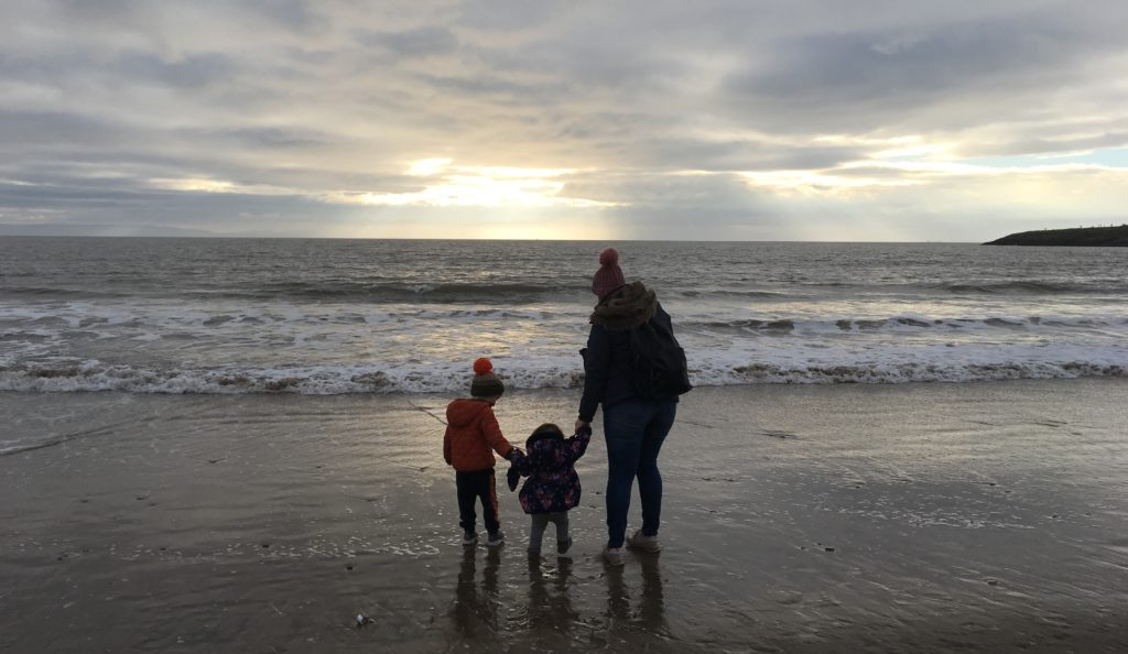 family walking on a beach im winter