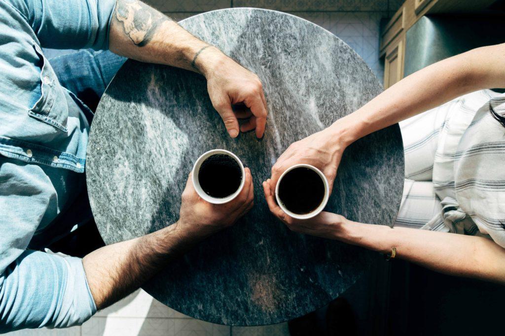 two people sat having coffee