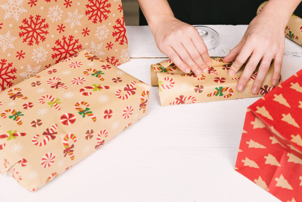 hands wrapping presents