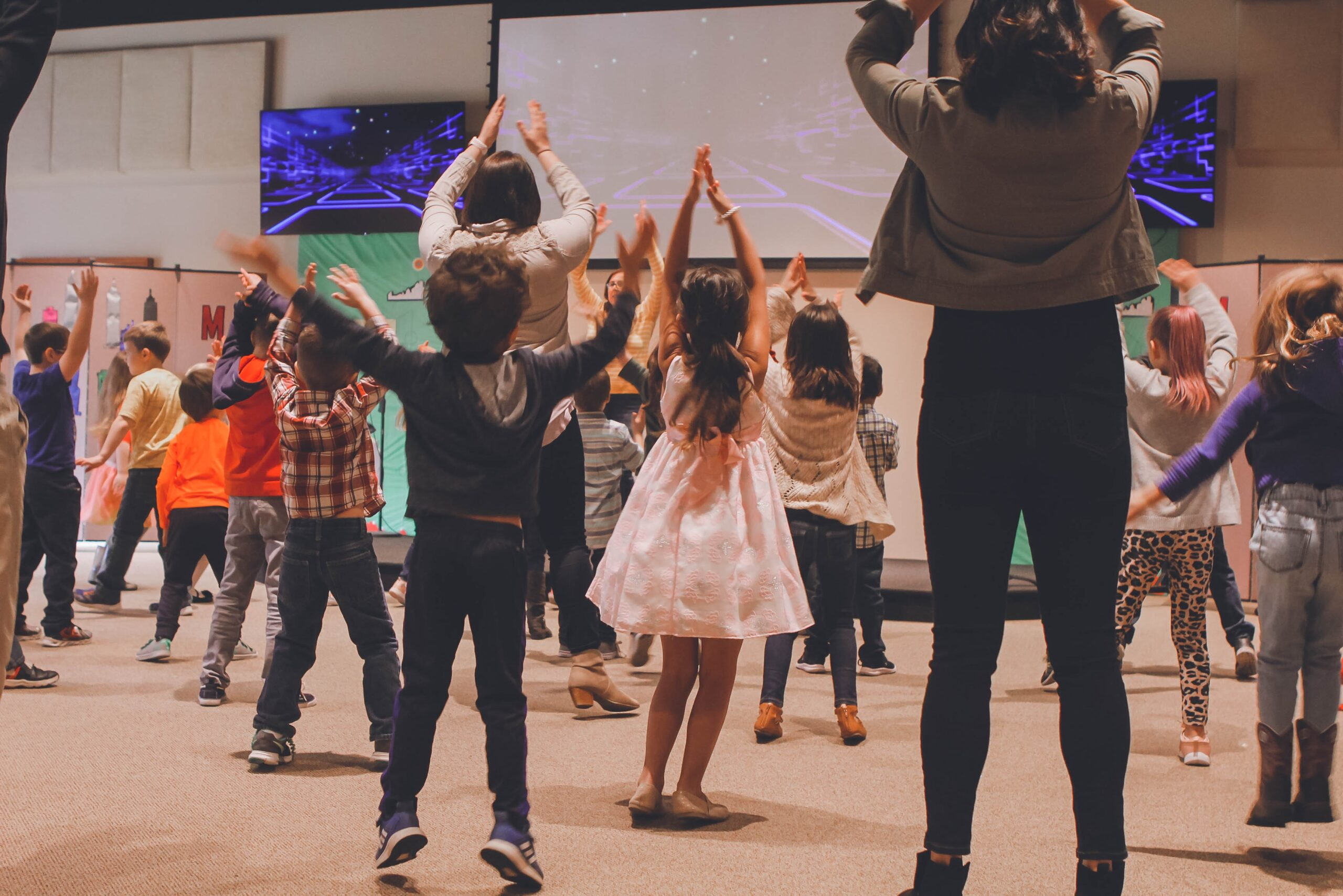 a group of children and adults take part in a movement class