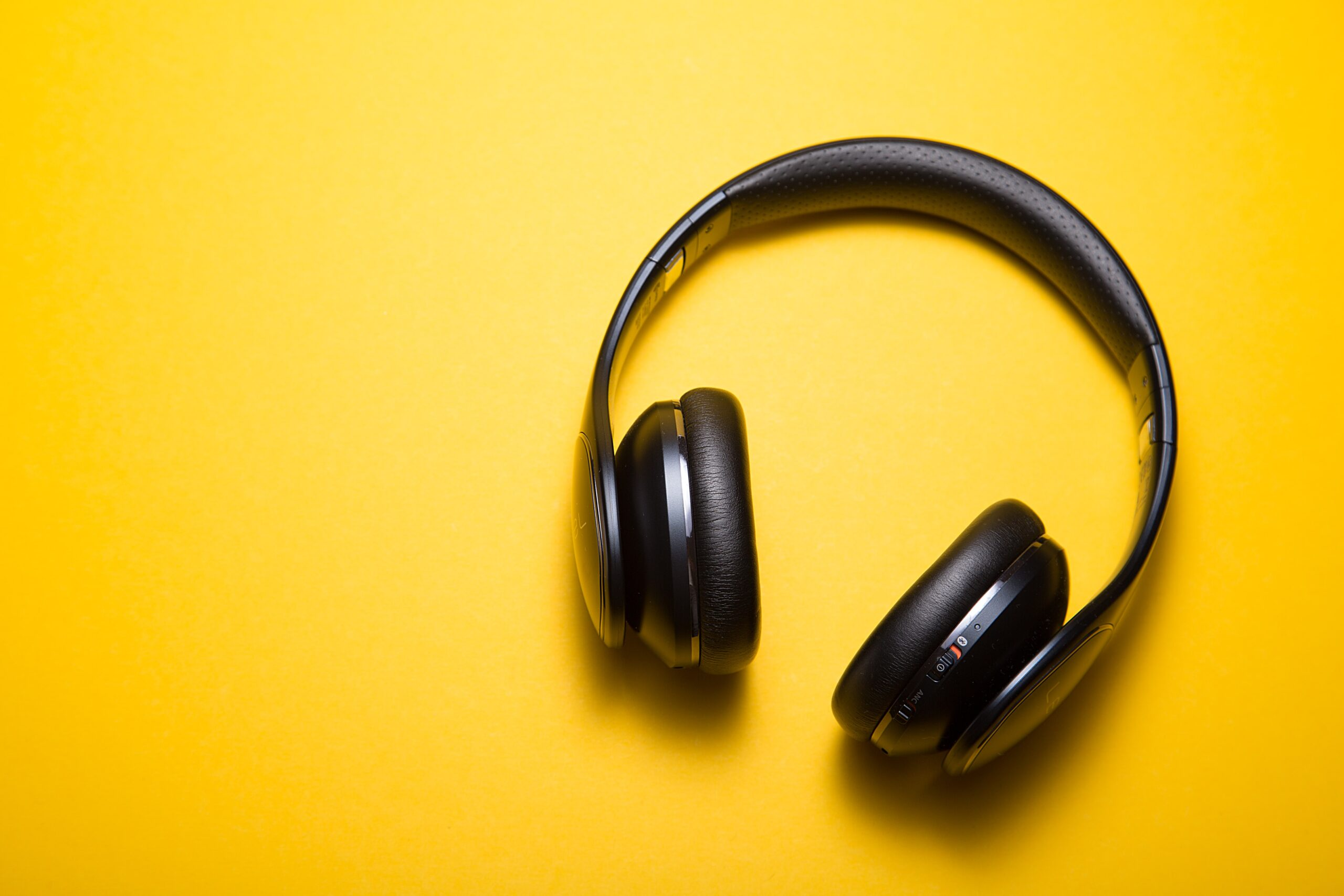 over the ear headphones on a yellow background