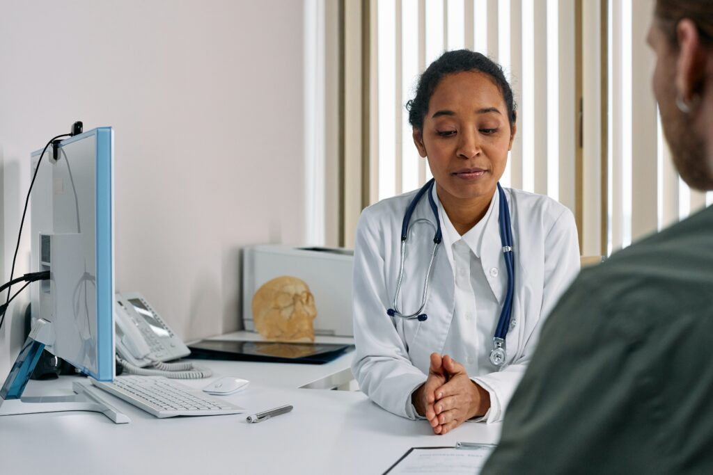 A doctor in her office gives advice to her patient.